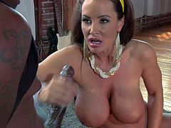 Experienced Dark haired milf Lisa Ann with huge firm fake tits and massive juicy ass polishes her twat while giving head and titjob to turned on black hunk with huge meaty bazooka