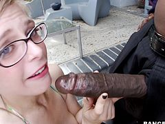 Penny is a whore that likes sucking big black cocks. When she sees such a huge dick like this guy has she goes insanely horny and starts sucking it. After having a taste of dick Penny goes on top and fills her pink shaved pussy with it. She's being ripped by that penis and loves it, maybe Penny will get cummed too