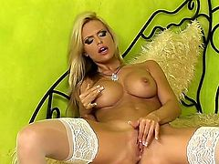 Have a look at delicious glamourous blonde chick Gitta Szoke in nice white stockings. She has beautiful lushy melons and she likes fingering her pretty soaked snatch