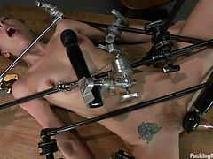 Sexy blonde bitch Chastity is all tied up on a table and gets her cunt fucked by a dildo machine. She has a vibrator attached to her clitoris, so that she could cum very easily. The speed is increasing and the slut feels better and better. Wanna watch this whore cumming and moaning with pleasure?