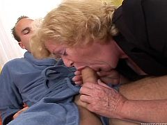 Nasty fat granny Alice is having some fun with her grandson's friend. She gives a hot blowjob to the guy and then lets him fuck her pussy in side-by-side position.