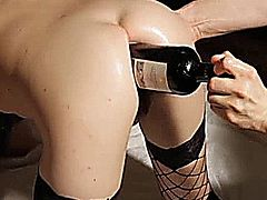 Extreme amateur babe has a huge bottle stuffed backwards in her destroyed gaping asshole