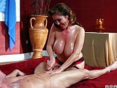 Kianna Dior is a sexy dressed topless milfy masseuse with huge boobs. Good looking lady in stockings and high heels rubs Johnny Sins nude body. He huge wet tits are totally exposed.