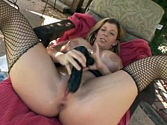 Fuckable busty milf rubs her wet juicy tits and appetizing ass intensively before she welcomes an oversized dildo in her mouth and later in pinkish shaved punani.