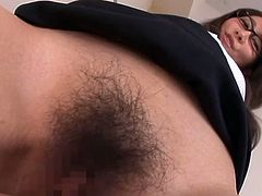 Adorable Japanese doctor fondles her hairy pussy and shows her stunning body. After that she takes big dick in her vagina.