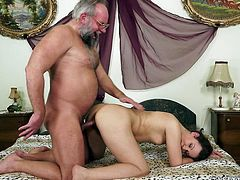 Brunette milf Hadjara has fun with some old guy in the bedroom. She lets him drill her hairy vag and gets her face covered with cum afterwards.