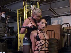 Andy Brown is having fun with Kathia Nobili in a basement. Kathia ties Andy up and then destroys her pussy with a dildo.