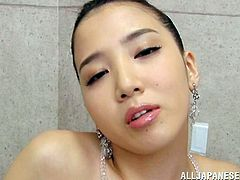 She has a firm, sensual body, long sexy legs and a angelic face with big, juicy lips. The Asian beauty may look like an angel but her mind is dirty and she likes getting facialized. Check her out as she receives some massive loads of warm semen on that pretty face. The jizz is flowing on her face!