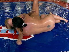 Two smoking hot babes are oiled up and ready for a ultimate wrestling match. Alysa and Ivana start fucking each other with a strapon at the end and that is nude fight club!