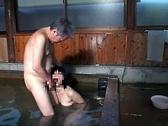 Japanese milf satisfies a few men in an indoor pool