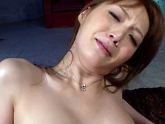 Salacious Japanese milf and some guy are playing dirty games in the living room. They pet each other and then have sex in cowgirl and other positions.