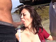 Hot Kaede Niiyama gets undressed at the beach. After that she sucks two big black cocks. Later on she gets fucked in her Asian pussy rough.