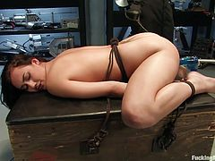 Get a load of this bondage clip where she submissive brunette's tied up and fucked by a machine as you hear her moan.