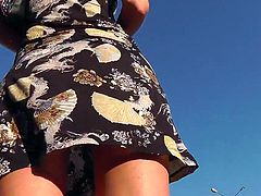 Horny voyeur gets very please when filming hottie under her skirt