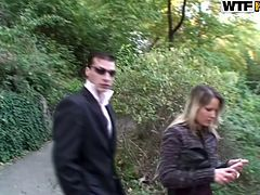 Aroused couple of newlyweds take a stroll at the park when an insatiable hubby forces his wifey to give him a head right at the street.