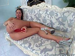 Attractive on of a kind black haired babe Simony Diamond with big juicy hooters and perfectly shaped big firm buns in stripper shoes only stuffs her honey pot with red dildo