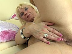 She still gets some action but this time the mature cunt Erika decides to play alone. The whore has her favorite dildo and she fucks her roomy, shaved pussy with it after she gave it a deep fingering. Yeah Erika has a lot of room in her vagina and surely she will need something bigger to reach satisfaction!