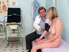 Sizzling granny with appetizing body comes to the medical appointment where she gets naked before she lays on the lounge in order to get her tasty pinkish twat poked with doctor's fingers in close up sex scenes by Old Pussy Exam.