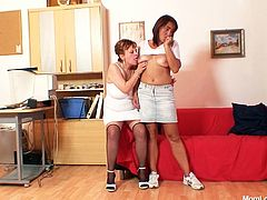 Insatiable red-haired boss makes her office manager get undressed before she sucks on her hard nipples and pokes her hairy pussy with her fingers in steamy lesbian sex clip by Mom Loves Mom.