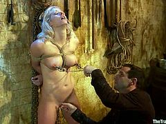 Sexy blonde doctor with hot tits get chained and humiliated in a dungeon. Later on she gets fingered and fucked rough.