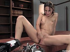 Take a look at this fucking machines scene where a kinky brunette cannot stop from cumming as she's fucked by them.