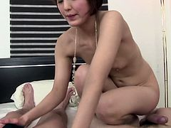 This Japanese MILF is tall and beautiful though she has got flat tits. She rubs two cock with her tender tootsies and then licks one of the guys all over tracing his body.