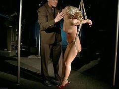 Young nude blonde with delicious ass and pretty face in red shoes only gets tied up in very uncomfortable position and tortured by filthy man in black suit in kinky bondage fantasy