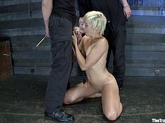 Get a load of this bondage scene where a naughty blonde slave is fucked by her masters while tied up with no chances of escaping.