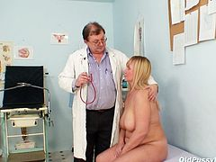 Well stacked blond granny bends over exposing her grey-haired punani for a hard finger fuck by rapacious doctor.