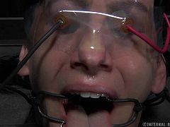Elise tries to scream for help, but the word can't be made out because of the clamps around her mouth and tongue. He master turns up the power on the electrodes attached to her face and pussy and she nearly passes out.