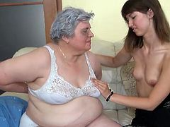 Nanny Luise is about to have some pleasure with her beautiful, young and slim girl. This fat and saggy woman knows that her girl loves her and she takes advantage of that. First they undress and kiss and then Luise licks her girls boobs before receiving the same thing. Maybe the girl will lick some fat pussy?