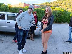Candy Alexa is a Russian slut who needs cock in her mouth. She pulls her top down to reveal her big, juicy, floppy tits. She kneels down behind a car and sucks of a lucky guy as a bunch of other Russians watch.
