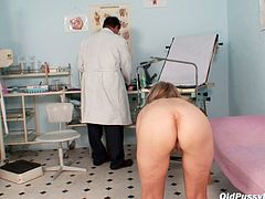 Disgusting shaved pussy of svelte blond mom gets finger fucked by rapacious doctor during the steamy gynecologcail examination presented by Old Pussy Exam.