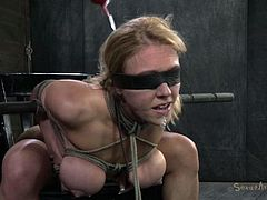 Darling is tied really hard on that chair and the executor took care she's immobilized and stays in a very uncomfortable position. With her boobs tied and squeezed, her mouth gagged and blindfolded too the blonde has little to say when he decides to roughly mouth fuck her. Wanna see what else she will endure?