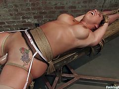 Watch this bondage scene where a horny blonde with sexy tan lines is fucked by a machine as she ends up soaked in her vaginal fluids.