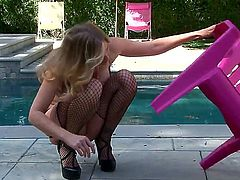 Julia Ann fingering her snatch in frond of the house