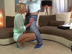 Elegant bespectacled blonde Ivana Sugar in see-through blouse and short skirt is cock hungry. Guy unzips his jeans and she takes his sausage in her eager sweet mouth. This euro babe sucks like a pro.