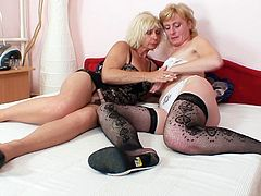 Perverse grannies polish each other's twats in sizzling lesbian sex session