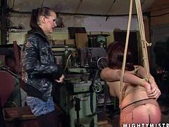 Rebellious long haired babe with big juicy hooters and smoking hot body gets tied up in uncomfortable positions by filthy milf and gets her firm ass spanked to red color