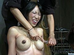 Horny Asian girl strips her clothes off and toys her pussy with a vibrator. After that she gets bonded and tortured.