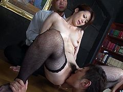 Ardent slim Japanese nympho with sweet tits undresses and wears only black stockings. Horn-mad slut wanna suck three cocks for cum at once. But she needs to be warmed. So her juicy hairy pussy is ready to be licked and tickled.