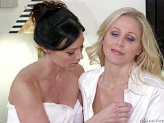 Sexy brunette Kendra Lust with nice boobs and ass gets completely naked in front of good looking busty mature blonde Julia Ann. Watch them have lesbian sex they wont soon forget.