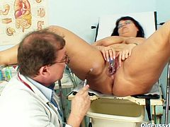 Insatiable doctor widens a gaped pussy of rapacious mom with a gynecological speculum before he starts pounding it with dildo.