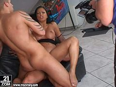 Good looking black haired whore Kyra Black with round fake tits and cheep heavy make up gets her holes drilled deep by two randy studs and sucks them simultaneously by billiard table