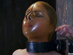 Her head is in some weird latex thing and her nipples are stretched by another strange tool. She gets a lot bloody stretches and that is so fucking weird!
