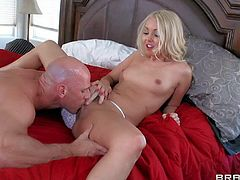 Aaliyah Love is one petite small titty blonde in white panties and pink shoes. She gives head to Johnny Sins on a king size bed and then gets her snatch banged with her panties on.