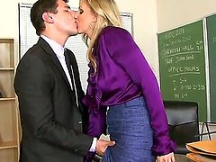 A guy in the black suit comes to luscious teacher Julia Ann and discuss some matters with her. But somewhere in the middles of their conversation she starts to undress.
