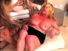 Watch the exciting and extremely hot lesbo porn with Debi Diamond and Ginger Lynn. Both so seductive blonde hotties are not only exposing delights but having lesbian sex too.