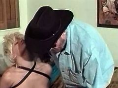 Bearded cowbow is all into foot fetish and spanking! His wifey is dressed as a slut and he gives her a nice spank on her sexy ass!