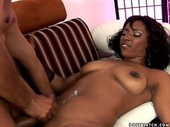 Horny ebony chick Belle De Leon gets naughty with her BF in the living room. They have hot oral sex and then bang in the reverse cowgirl position.